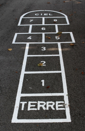 amusement park black and white: Hopscotch with french words terre  ground  and ciel  sky  on the schoolyard Stock Photo