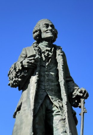 essayist: Ancient statue of the famous french philosopher Voltaire  1694-1778  at Ferney-Voltaire, France