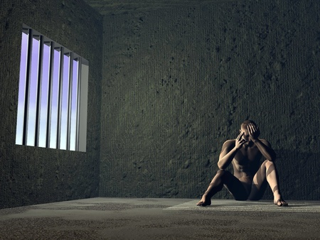 Sad man sitting in jail next to a window with bars, sunlight on him