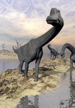 Three brachiosaurus dinosaurs in desert near water with reflection by sunset and full moon