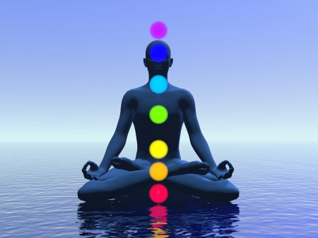 energy healing: Silhouette of a man meditating with seven colorful chakras upon ocean by blue light