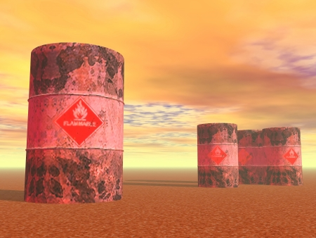 danger symbol: Three barrels with flame sign on the ground by sunset light Stock Photo