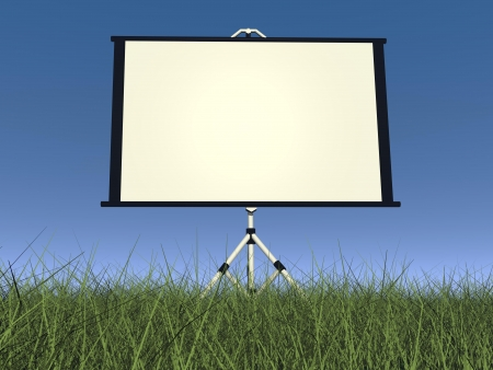 Empty white projection screen in nature with green grass and blue sky photo