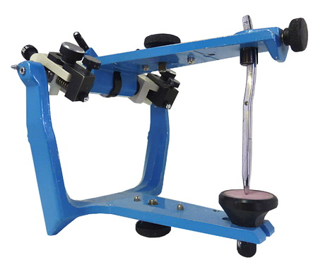 articulator: Blue metallic articulator used in dentistry isolated on white background Stock Photo