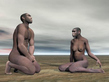 Male and female homo erectus bust sitting on the ground by grey cloudy day photo