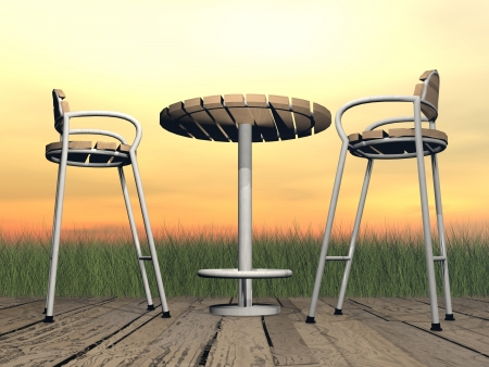 patio chair: Two chairs and one table on a wooden floor in front of the garden by sunset light