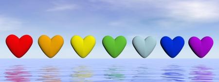 Sept coeurs dans une rangée avec des couleurs de chakra sur l'eau par beau jour
