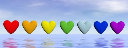 energy healing: Seven hearts in a row with chakra colors upon water by beautiful day Stock Photo