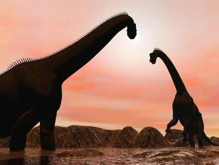 brachiosaurus: Two brachiosaurus dinosaurs silhouettes in water next to mountains by sunset Stock Photo