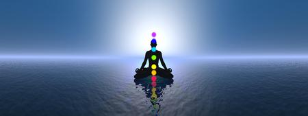 Silhouette of a man meditating with seven colorful chakras upon ocean by blue sunset, 360 degrees effect