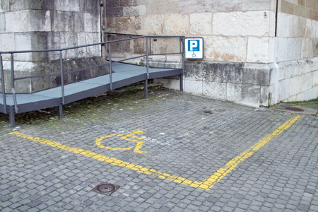 Handicapped parking space in old city, Geneva, Switzerland photo