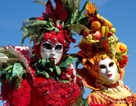 Beautiful colorful persons with lots of fruits at the 2014 Annecy venetian carnival, France photo