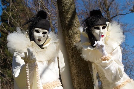 Black and white Pierrot couple at the 2014 Annecy venetian carnival, France photo