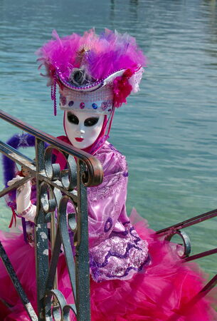 Pink and white person at the 2014 venetian carnival of Annecy, France photo
