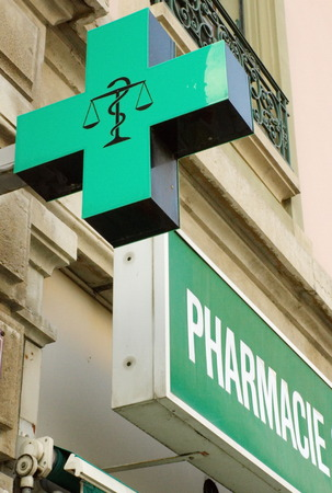 cross street with care: French pharmacy sign