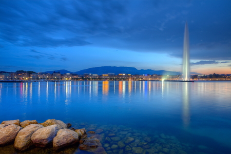 Geneva, Switzerland, October 12, 2014 : famous fountain and lakeside, HDR