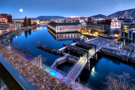 city in the night: BFM, cathedral tower and Rhone river, Geneva, Switzerland, HDR