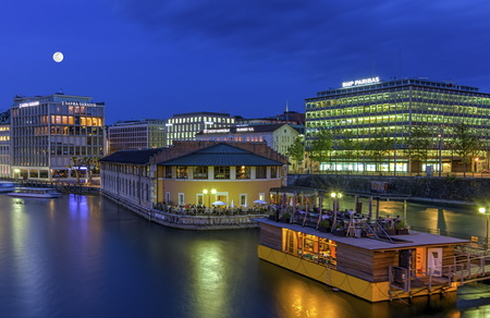 office buildings: Urban view with bank district by night, Geneva, Switzerland, HDR Editorial