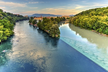 confluence: Rhone and Arve river confluence by sunset, Geneva, Switzerland, HDR Stock Photo