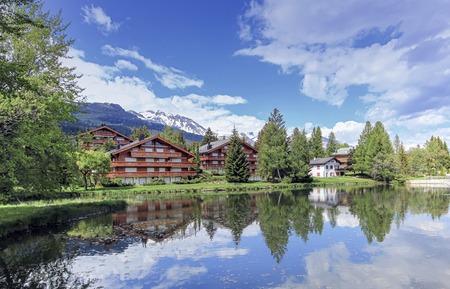 valais: Chalets and lake at Crans-Montana by beautiful day, Valais, Switzerland