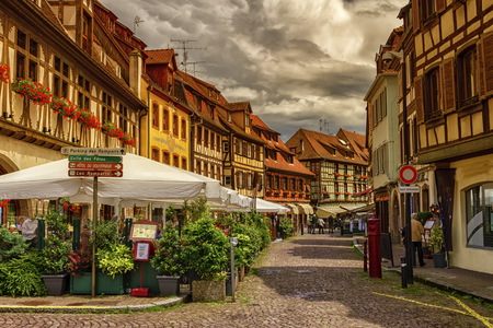 des vins: Street with restaurants in Obernai village, Alsace, France