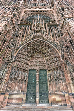 cathedrale: Frontispiece of the facade of Cathedrale Notre-Dame or Cathedral of Our Lady of Strasbourg with all detailed sculptures, Alsace, France Stock Photo