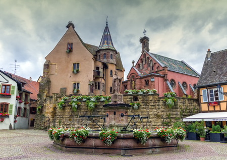 timbered: Saint-Leon fountain and traditional timbered houses in Eguisheim, Alsace, France