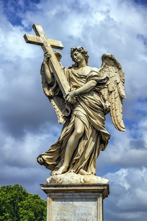bernini: Angel with the Cross statue on the Ponte Sant Angelo bridge by day, Rome, Italy Stock Photo