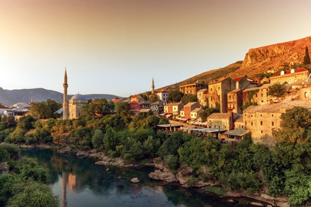 bosnia hercegovina: View of Neretva river and old city of Mostar old city by sunset, Bosnia and Herzegovina Stock Photo