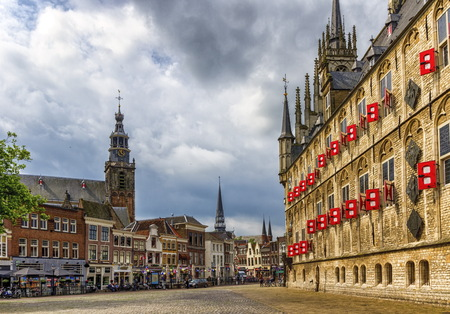 Market square with gothic city hall in Gouda, South Holland, Netherland Фото со стока