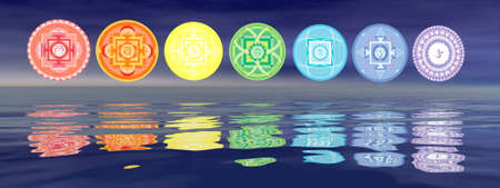 Seven chakra symbols line with reflection from the water