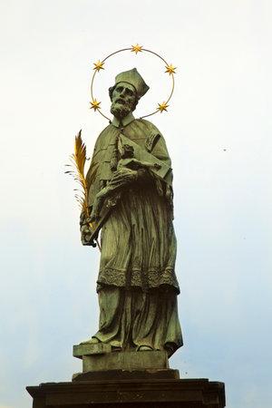 PRAGUE, CZECH REPUBLIC, 30 DECEMBER 2018. Statue of St. John of Nepomuk on Charles Bridge in Prague, Czech Republic.