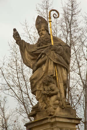 PRAGUE, CZECH REPUBLIC, 31 DECEMBER 2018. The statue of  St. Augustinus  on Charles Bridge in Prague, Czech Republic. 報道画像