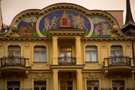 KARLOVY VARY, CZECH REPUBLIC 01 JANUARY 2019. Frescoes on the facade of the Art  Nouveau building in Karlovy Vary, Czech Republic.