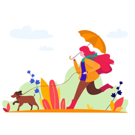 Woman walking a dog in autumn with umbrella.