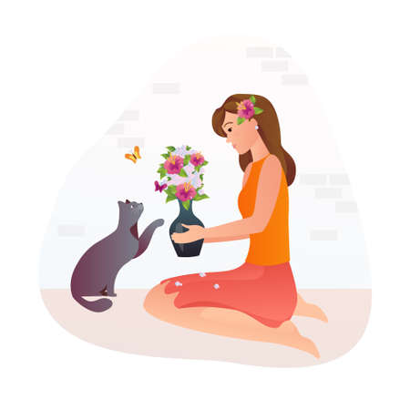 Girl holds a vase with flowers in her hands. The cat is smelling flowers.