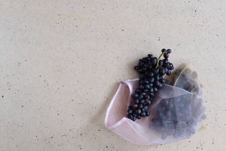 Zero waste food and plastic free shopping concept. Black grape in cotton bag. Stock Photo - 134722236