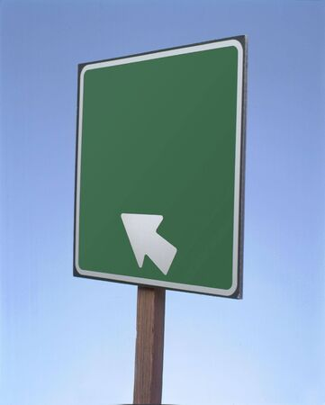 Blank directional road sign photographed in studio.