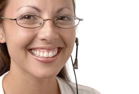 big smile: Young woman wearing a headset and a big smile.
