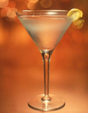 especially: Martini with lemon twist and room made especially on the glass for copy.