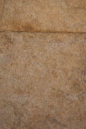 Granite rock texture with natural seam.