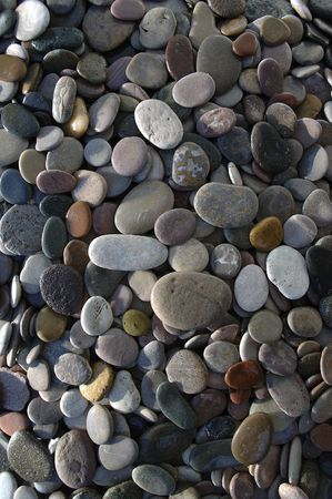 Disc Shaped river stones. Crops nicely into closer sections. This hand assembled background of stones has no gaps or debris in the pattern Stock Photo - 203984