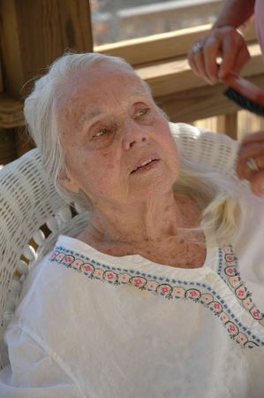 great grandmother: Great Grandmother having her hair brushed. Stock Photo