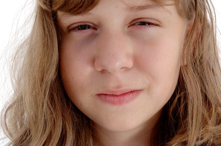 antagonistic: 13 year old girl with a demonic expression on her face. Stock Photo