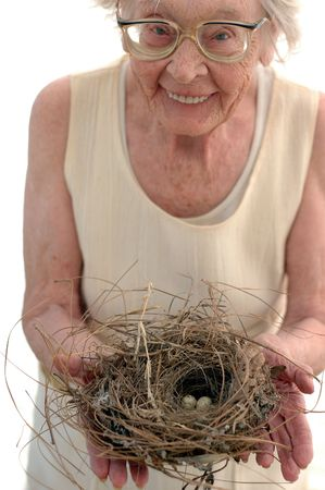 80 year old: Nature Lover 80 year old woman with birds nest. Stock Photo