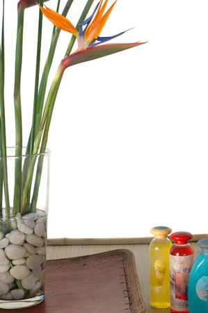 Bird Of Paradise flowers on white background sitting on a asian tray with spa cosmetics. (Generic art labels.) photo