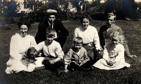 a generation: Vintage Generations. Family with grandparents, parents, and children. Circa 1910 print has scratches,  fading,  artifacts, and solarization qualities.
