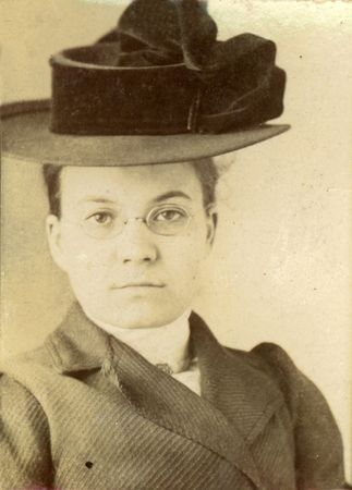 Vintage print of a young woman in a stylish hat. Circa 1910 print has scratches, artifacts, fading and solarization qualities. photo