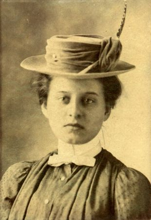 Vintage protrait of a young woman in a hat. Circa 1910 print has scratches, artifacts, fading and solarization qualities.