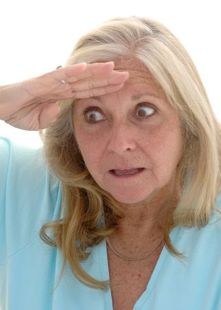 late fifties: Woman in her late fifties looking with funny expression photographed on a white background.